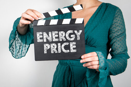 Energy Price. Woman hands holding black Clapperboard