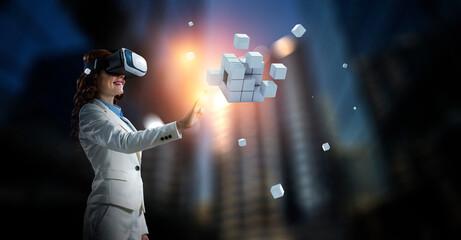 Fototapeta Woman wearing virtual reality goggles obraz
