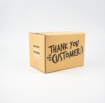 A closed cardboard box taped up, and there is a Thank you for being our customer beside the parcel box for delivery and shopping online concept design isolated on white background.