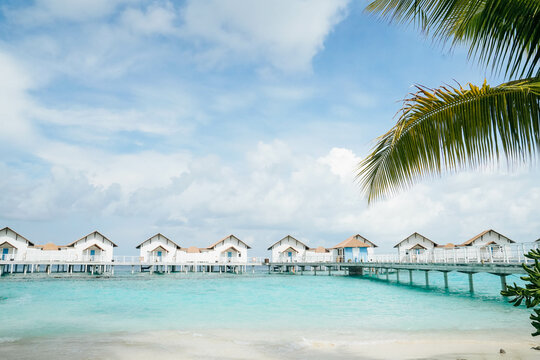 Beautiful Landscape of Over ocean Tropical beach summer resort hotel and spa, Maldives island with sea and sky tranquil for holiday vacation