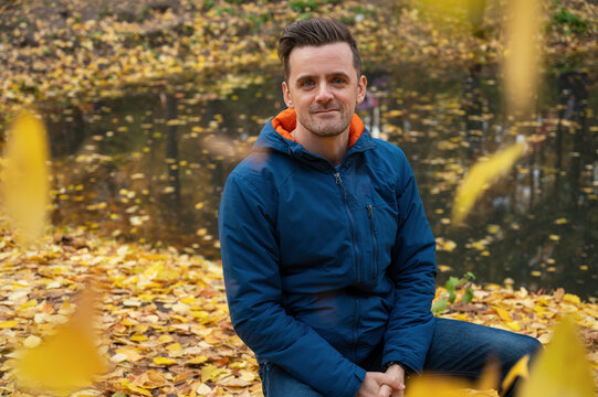 Autumn portrait of man on fall nature background