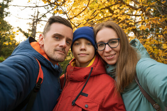 Happy family selfie in autumn park on fall nature background