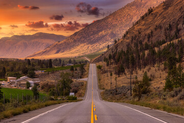 Fototapeta Scenic Road, Hwy 3, in the valley around the Canadian Mountain Landscape. Colorful Sunset Sky Art Render. Near Osoyoos, British Columbia, Canada. obraz