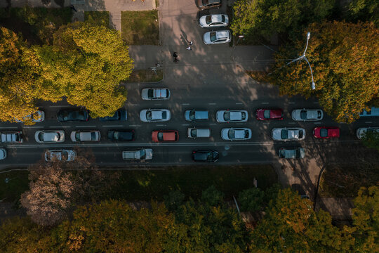 Drones point of view - traffic jam top view, transportation concept, intersection crossroad aerial view from above. Road traffic on crossroad or intersection downtown.