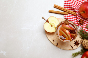 Obraz Aromatic hot mulled cider on light grey marble table, flat lay. Space for text - fototapety do salonu