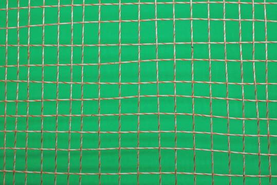 white red  fabric texture of fine mesh on crumpled matter on a green background