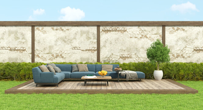 Modern blue sofa in a garden on deck floor