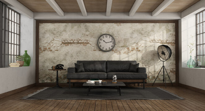 Vintage living room with black sofa against old wall