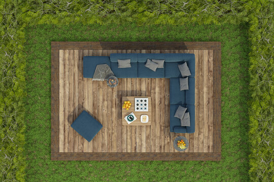 High angle view of a garden with sofa on a wooden deck floor on grass