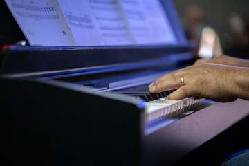 Indian man hands playing electric piano. copy space