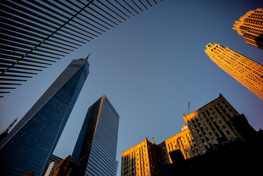 USA, New York, New York City, Tall downtown skyscrapers against clear sky at dusk
