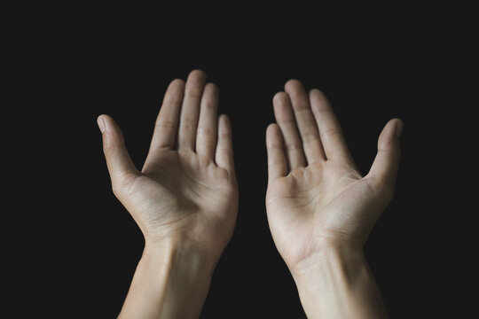 Praying hands. Black background. Make a wish in God. Faith in religion and belief in God on the power of hope or love and devotion.