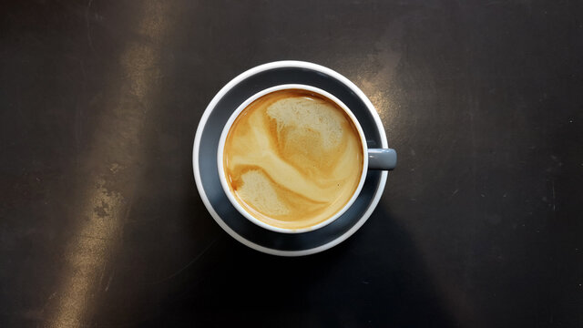 a cup of latte art coffee for background