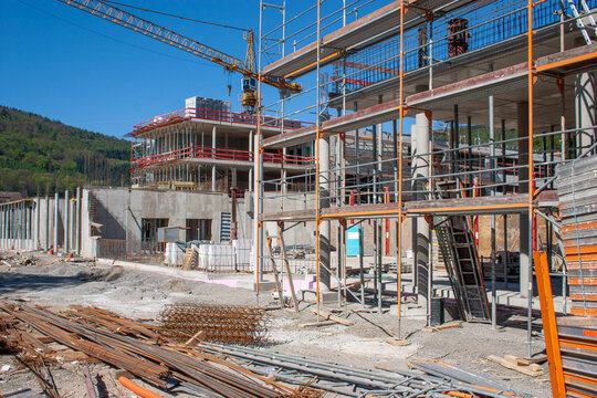 construction site during the erection of a building with reinforced concrete and construction crane