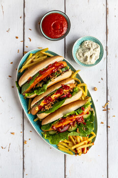 Hot dogs with french fries, ketchup and mayonnaise