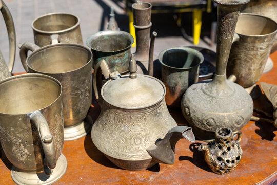 Vintage copper tableware for sale at the flea market