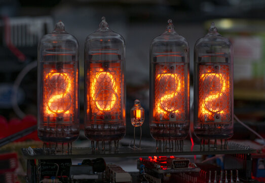 retro Nixie lamp indicator clock on dark background 2022 number