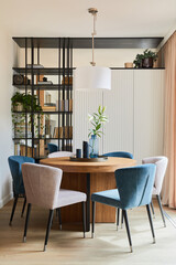 Obraz Stylish elegant dining room interior design composition with velvet armchairs, design rouded wooden table and beautiful personal accessories. Glamour interior design inspiration. Template.. - fototapety do salonu