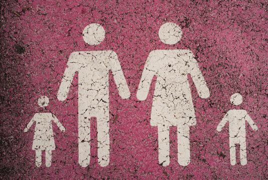 Family parking red symbols on asphalt
