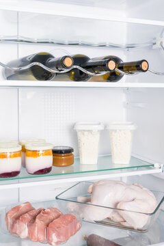 wine and food on the shelf in the refrigerator