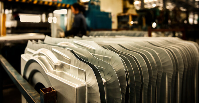 Neatly stacked steel plate raw materials inside the factory