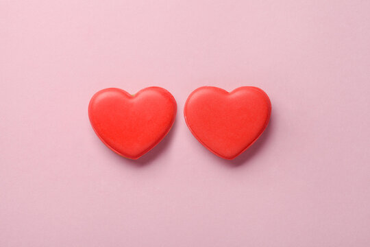 Two heart shaped cakes on pastel pink background, love, marriage concept, Valentines day card