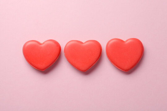 Heart shaped cakes on pastel pink background, love, family concept, Valentines day card