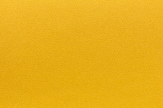 Textured surface of yellow paper