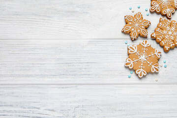 Obraz Tasty Christmas cookies on white wooden table, flat lay. Space for text - fototapety do salonu