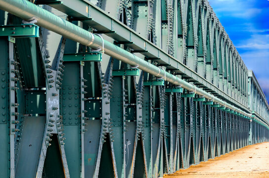 old steel bridge structure with rivets and screws over the Danube river at Tulln, Austria