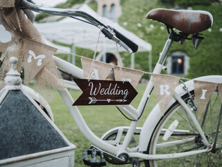 White wedding bicycle decoration with a green background