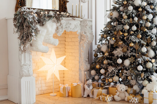 Christmas tree by the fireplace. home decoration for Christmas and new year. High quality photo