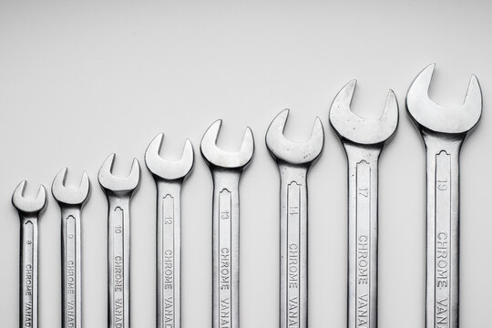 A set of wrenches lined up in a row. It looks like a growing graph