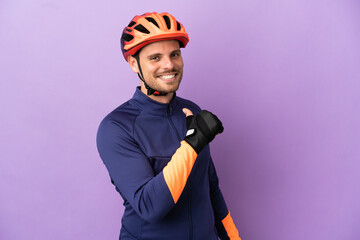 Fototapeta Young Brazilian cyclist man isolated on purple background proud and self-satisfied obraz