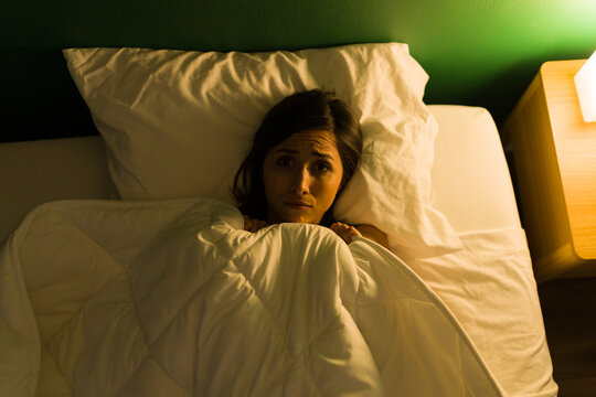 Scared young woman can't sleep