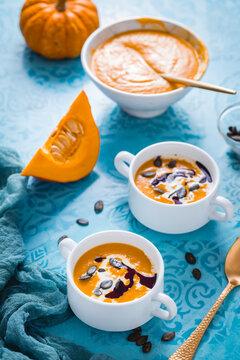 Homemade pumpkin soup with coconut milk, pumpkin oil and seeds