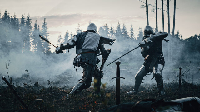 Epic Battlefield: Two Armored Medieval Knights Fighting with Swords. Dark Ages Army Warfare. Action Battle of Armed Warrior Soldiers, Killing Enemy. Cinematic Historical Reenactment.