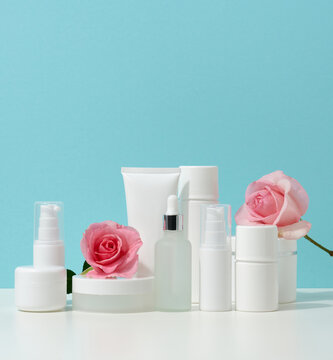 jar, bottle and empty white plastic tubes for cosmetics on a white table. Packaging for cream, gel, serum, advertising and product promotion, mock up