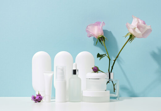 empty white plastic tubes and jars for cosmetics. Packaging for cream, gel, serum, advertising and product promotion, mock up