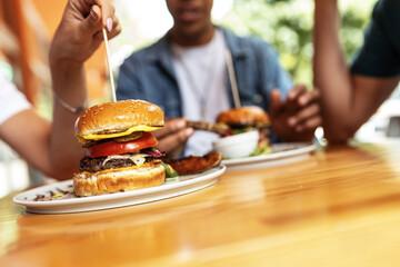 Obraz Burger with veggies, meat and crispy bacon.  - fototapety do salonu