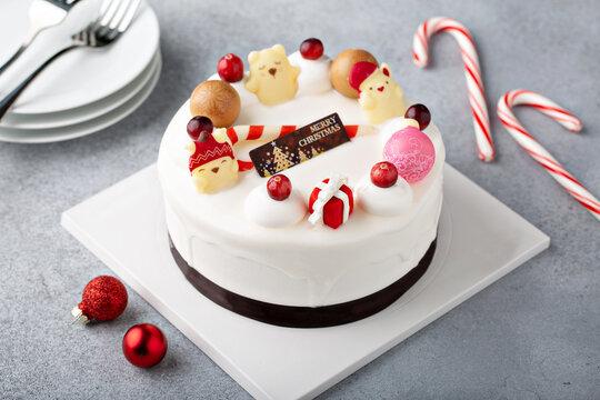 White chocolate Christmas celebration cake with holiday decorations