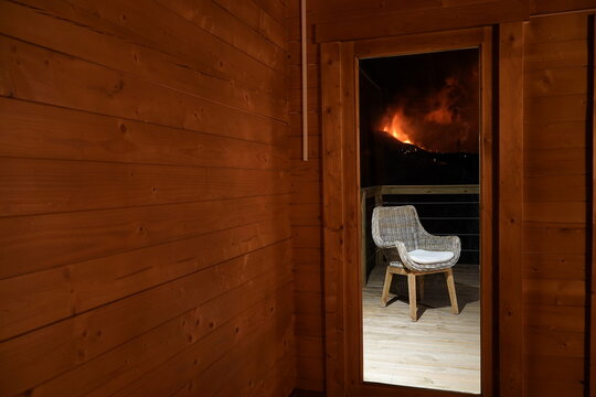 Lava is seen through a window of a home in El Paso following the eruption of a volcano on the Canary Island of La Palma