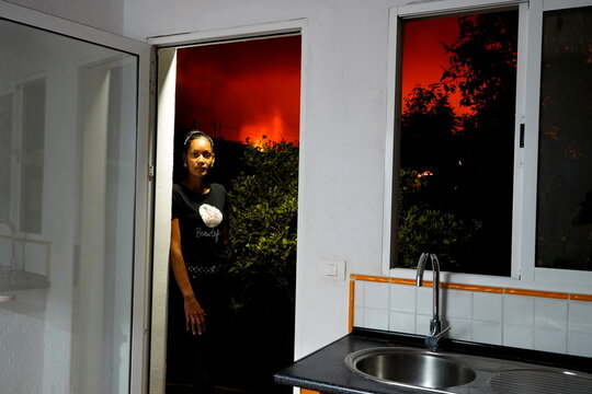 Jacqueline Peralta stands in a doorway in her home, from which lava can be seen in El Paso