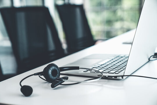 Headset and customer support equipment at call center ready for actively service . Corporate business help desk and telephone assistance concept .