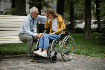 Obraz Father takes care of a disabled daughter - fototapety do salonu