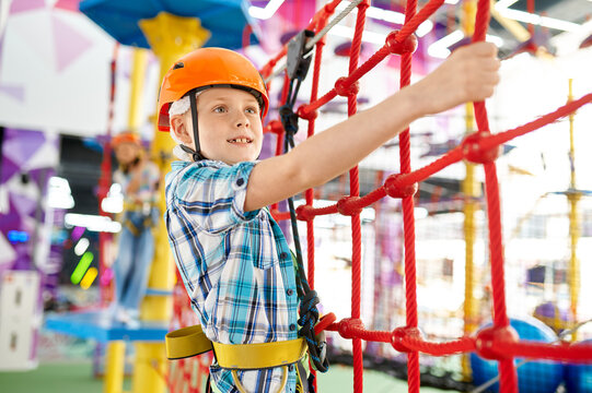 Little boy on zip line in entertainment center