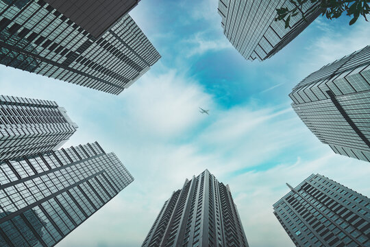 Bottom view of beautiful skyscrapers under a cloudy sky in Jakarta city, Indonesia