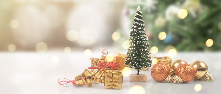 Decorated Christmas tree hanging on pine branches and gift boxes