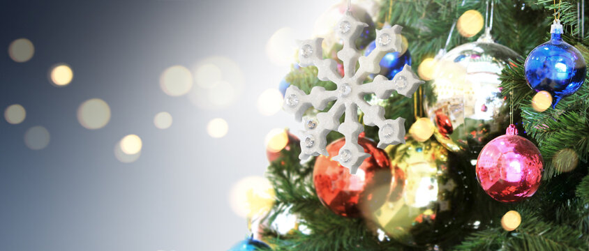 Decorated Christmas tree hanging on pine branches