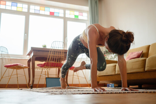 Relaxed woman doing fitness exercises  at home